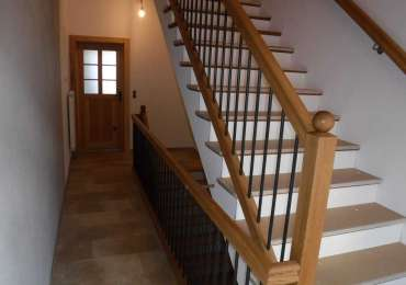 Treppengeländer in Eiche mit Eisenstäbe